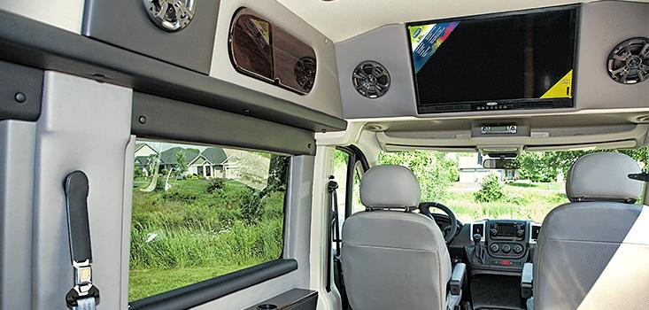 Rollx Vans Dodge Ram Promaster wheelchair van driver behind seat