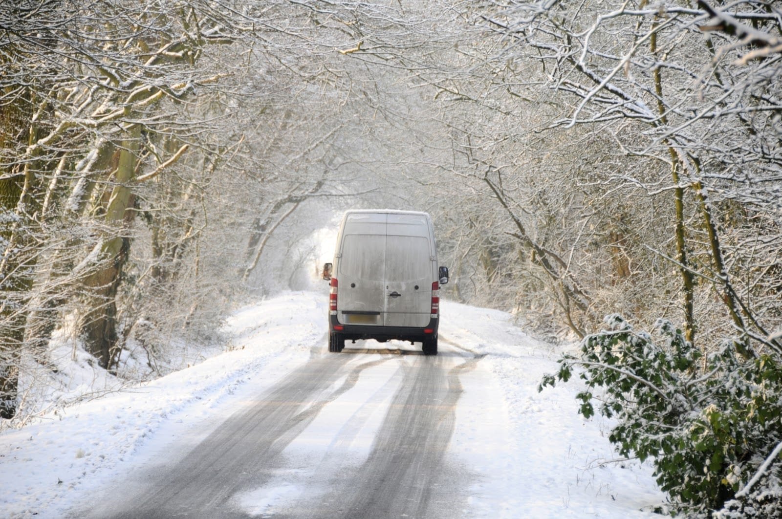 A van driving in hazardous conditions