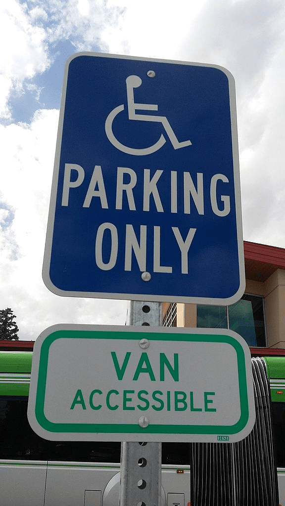 A sign for a handicap access vans handicap parking spot
